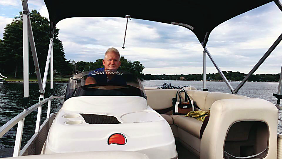 Captain Scotty V. on his pontoon at his home in Weatherby Lake!